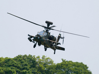 AH-64D Apache flight exhibition close in Stock photo [695499] AH-64D