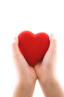 The hands of the women with a red heart Stock photo [698385] Hart
