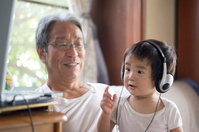 1-year-old child to enjoy a personal computer down with headphones Stock photo [1532067] Headphone