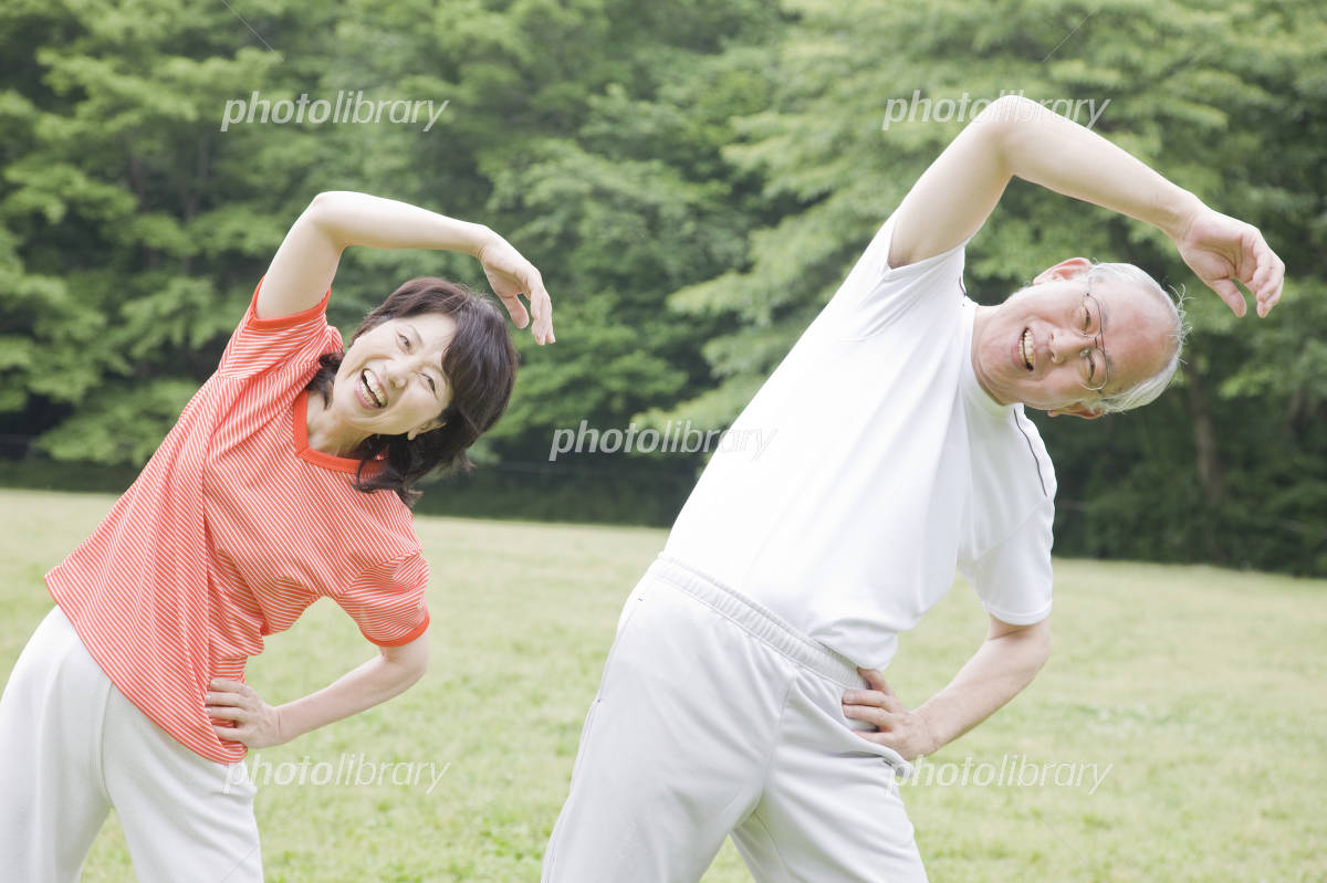 Elderly couple to the radio gymnastics in the park Photo