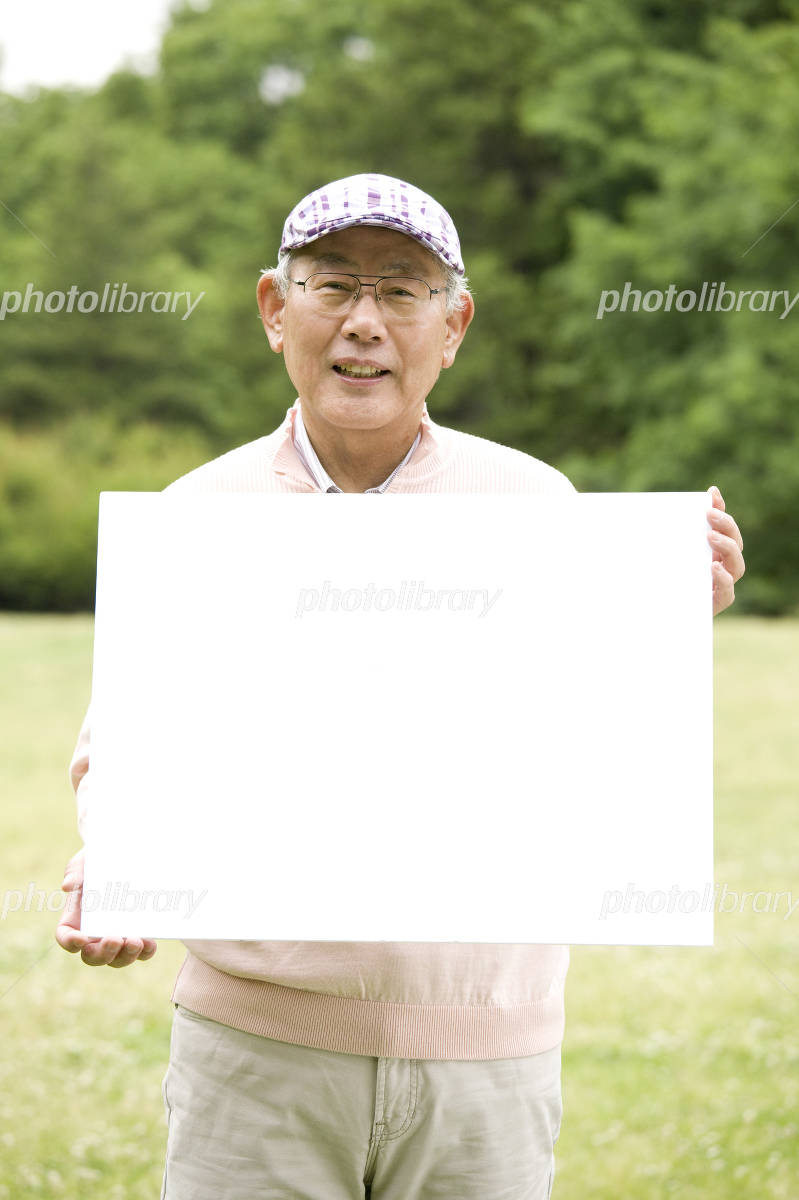 Old man has a message board in the park Photo