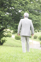 From behind the old man to walk while month cane the park Stock photo [2390712] 1