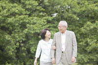 Elderly couple to walk in the park while assembled the arm Stock photo [2390730] 2