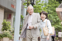 Elderly couple walking while assembled arms around town Stock photo [2390757] 2