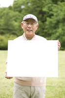 Old man has a message board in the park Stock photo [2390852] 1