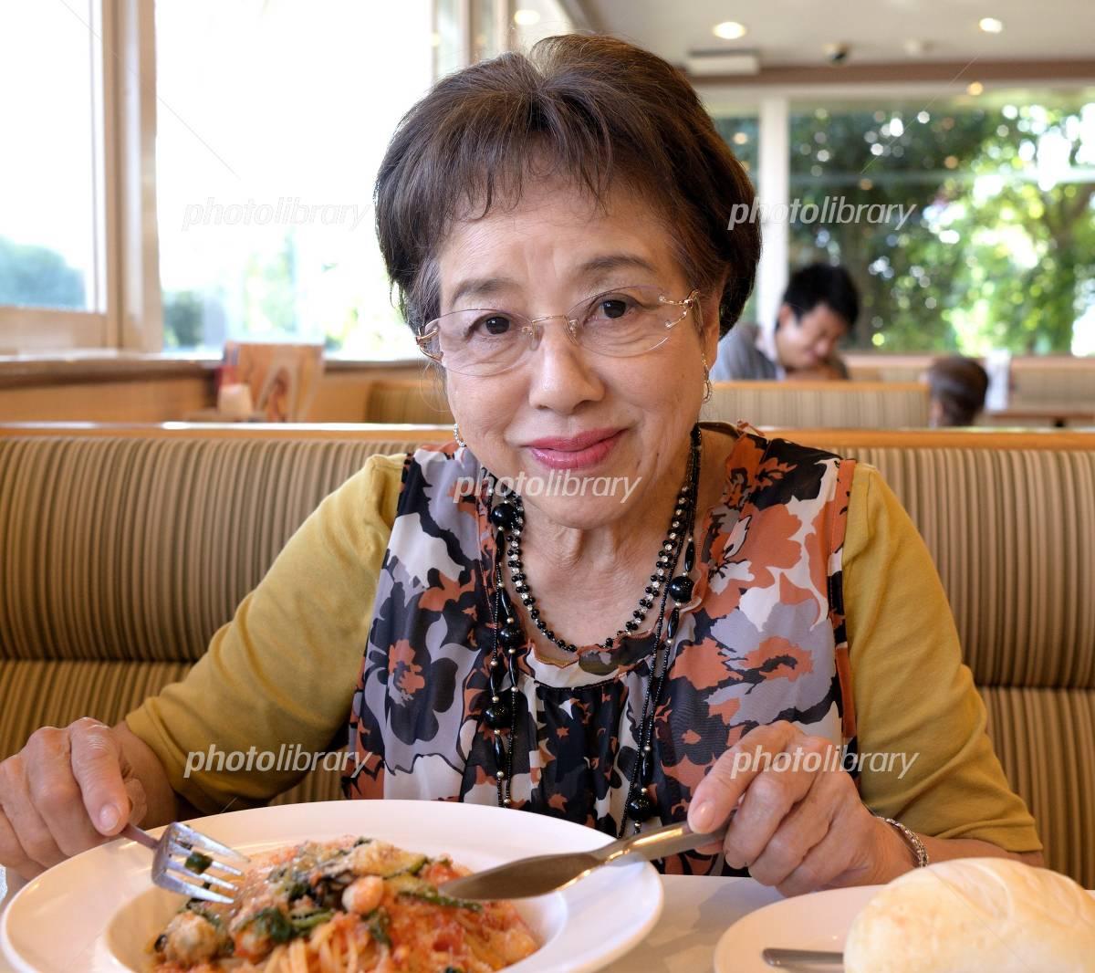 Senior woman to eat Photo