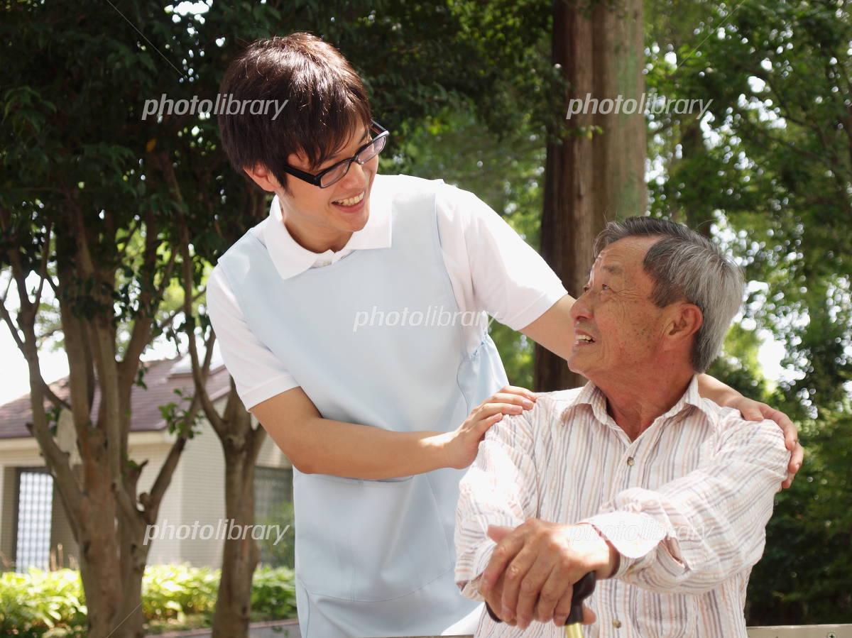 Senior and helper Photo