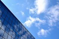 Blue sky reflected in the building stock photo