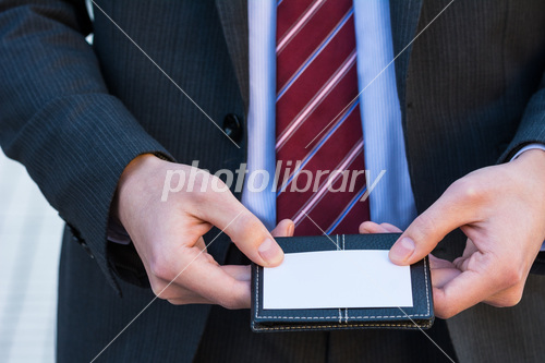 Businessman with business card Photo