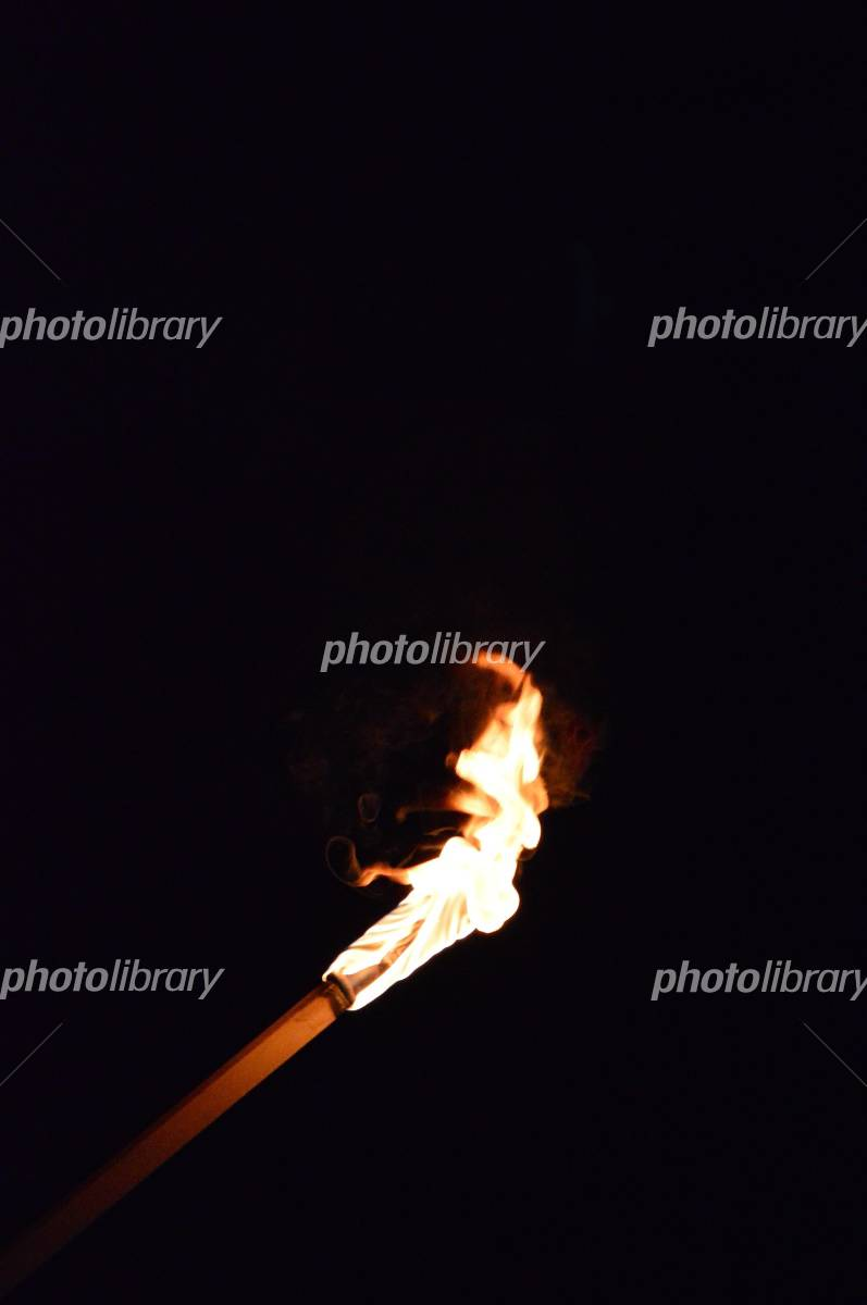 Flame black background of the torch Photo