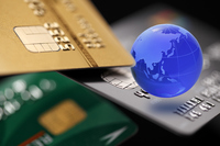 Earth's global business image / credit card and glass Stock photo [4346583] International