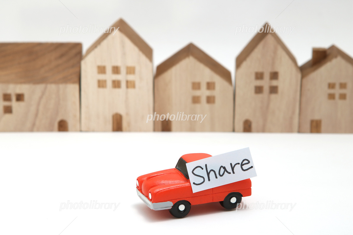 Miniature house and minicar car sharing image Photo
