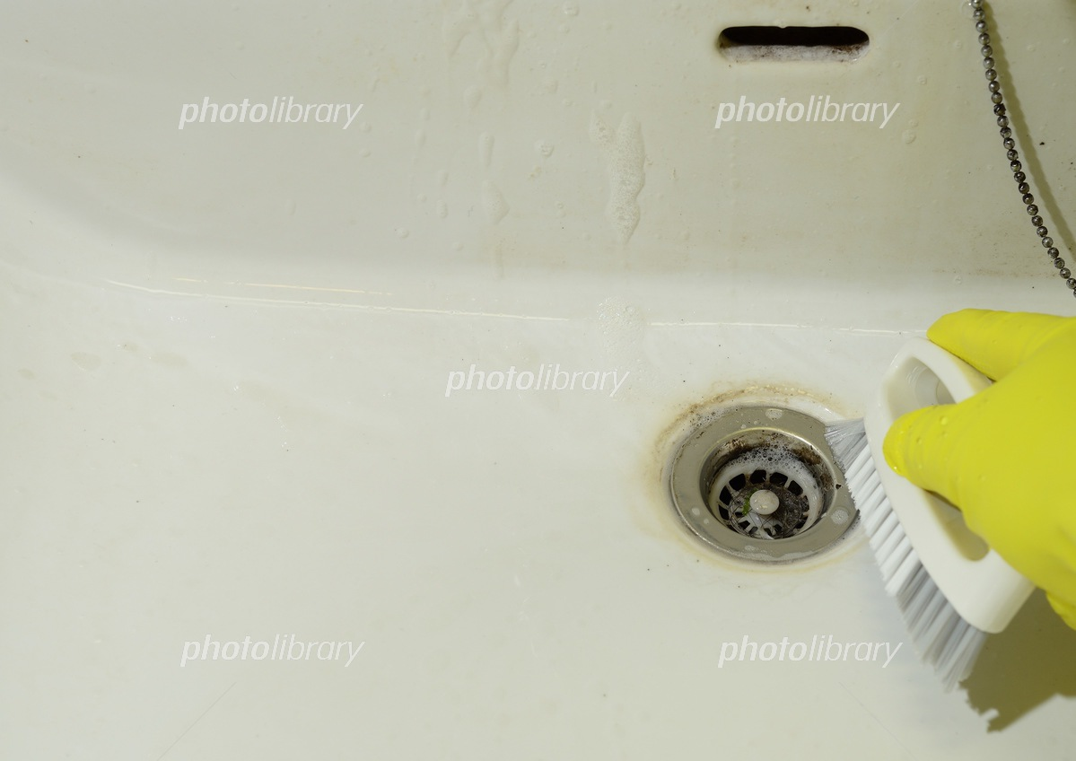 Cleaning the dirty washbasin Photo