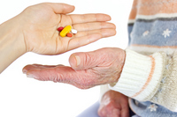 Young hand handing over medicine to senior Stock photo [1272751] Zinnia