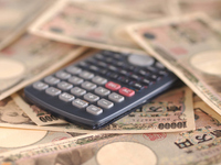 Calculator and ten thousand yen bills Stock photo [2153430] Calculator