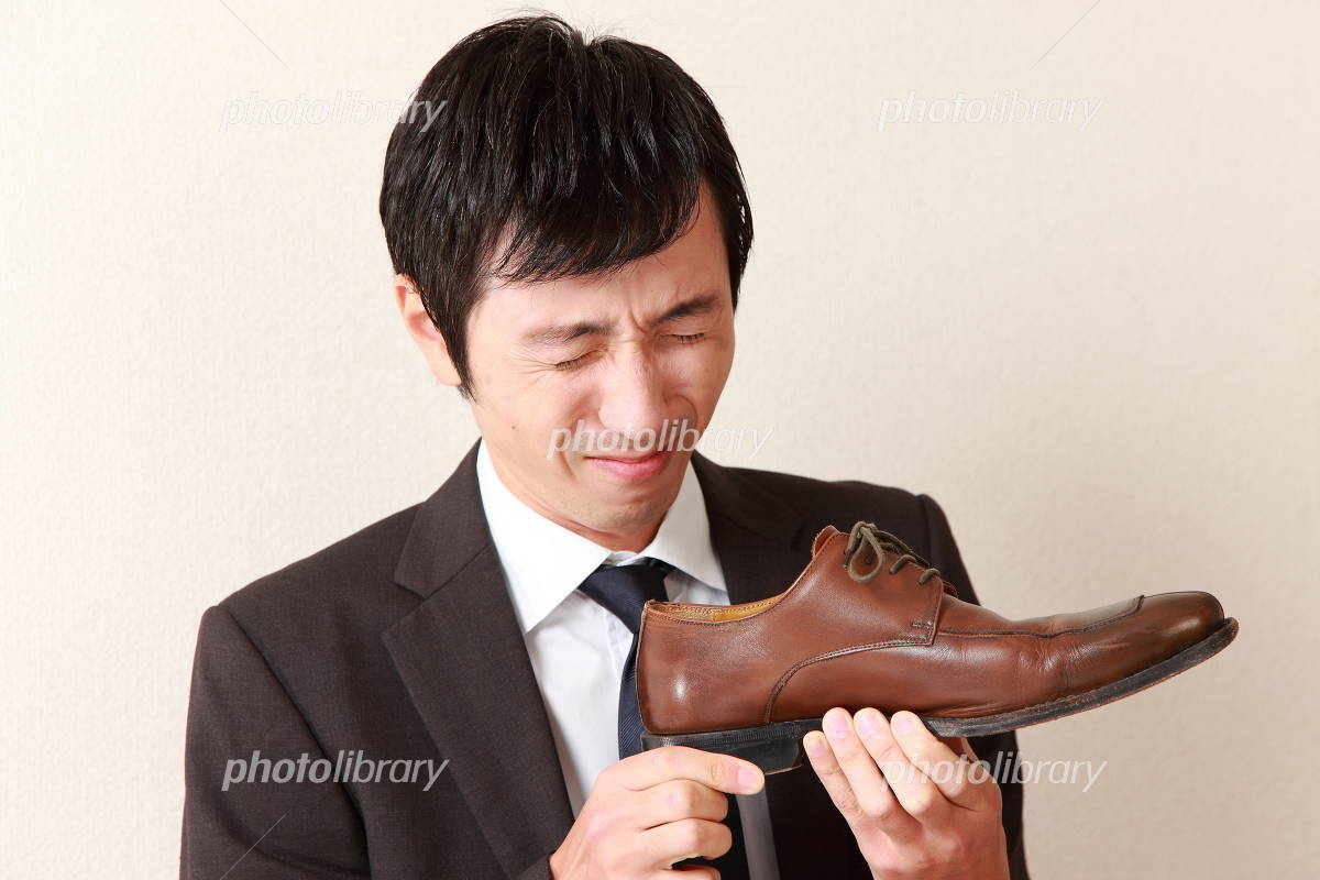 Businessman to be fed up to the smell of shoes Photo