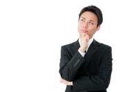 Young businessman thinking with a little upturned Stock photo [2270459] Business