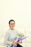 Received a bouquet of Mother's Day, smile mom Stock photo [2277054] Mother's