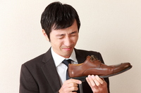 Businessman to be fed up to the smell of shoes Stock photo [2278141] Shoes
