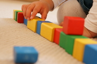 Girl playing with building blocks Stock photo [2279546] Person