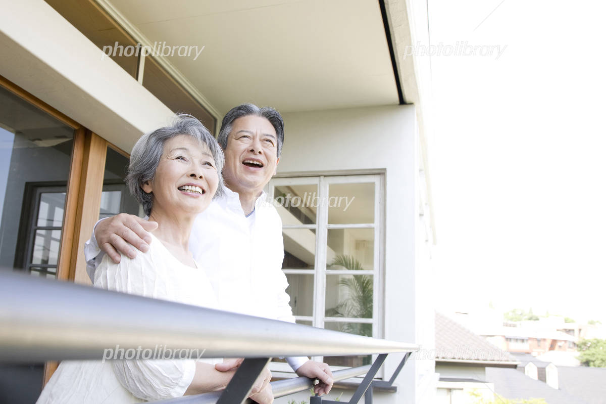Elderly couple laughing on the porch Photo