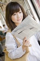 Woman read the newspaper on the train Stock photo [2401169] People