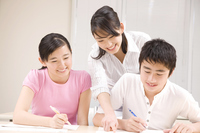 Men and women that taught a study to cram school teacher Stock photo [2410478] Happy