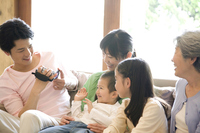 Father to shoot his son to be embraced by the mother in the video camera Stock photo [2412142] Dad