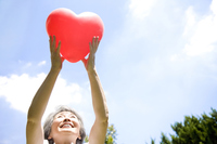 Senior woman with a heart-shaped balloon Stock photo [2412187] People