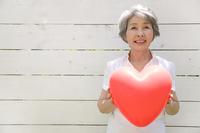 Senior women with heart balloons Stock photo [2412191] 1