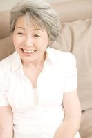 Senior woman sitting on the sofa Stock photo [2412205] 1