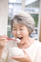 Senior women who eat white rice Stock photo [2412806] 1