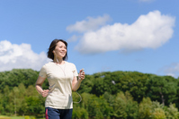Woman to be walking while listening to music on your smartphone Stock photo [2726861] Jogging