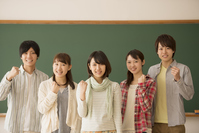College students to the guts pose in front of a blackboard Stock photo [3973169] College