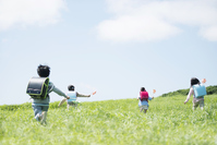 Elementary school students running the grassland has a windmill Stock photo [3973860] Primary