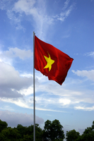 Vietnam flag that trail in the blue sky Stock photo [153605] Vietnam
