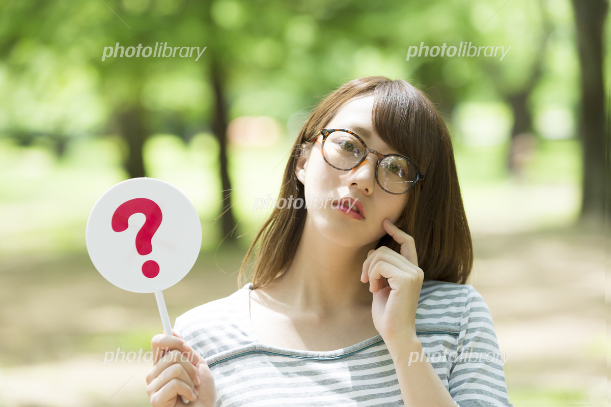 A woman's park of spectacles giving a question mark Photo