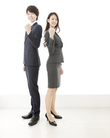 写真 Businessman & business woman doing guts pose(5471456)