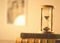 Ticking hourglass and forehead on the Books Stock photo [527334] When