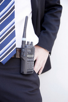 Businessman to put the transceiver to the waist 1