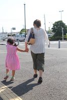 Parent and child walk hand in hand Stock photo [1558675] Parent-child