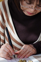 Woman writing a letter with a brush pen Stock photo [1569385] Letter