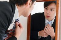 Businessman tighten the tie Stock photo [1845702] Businessman