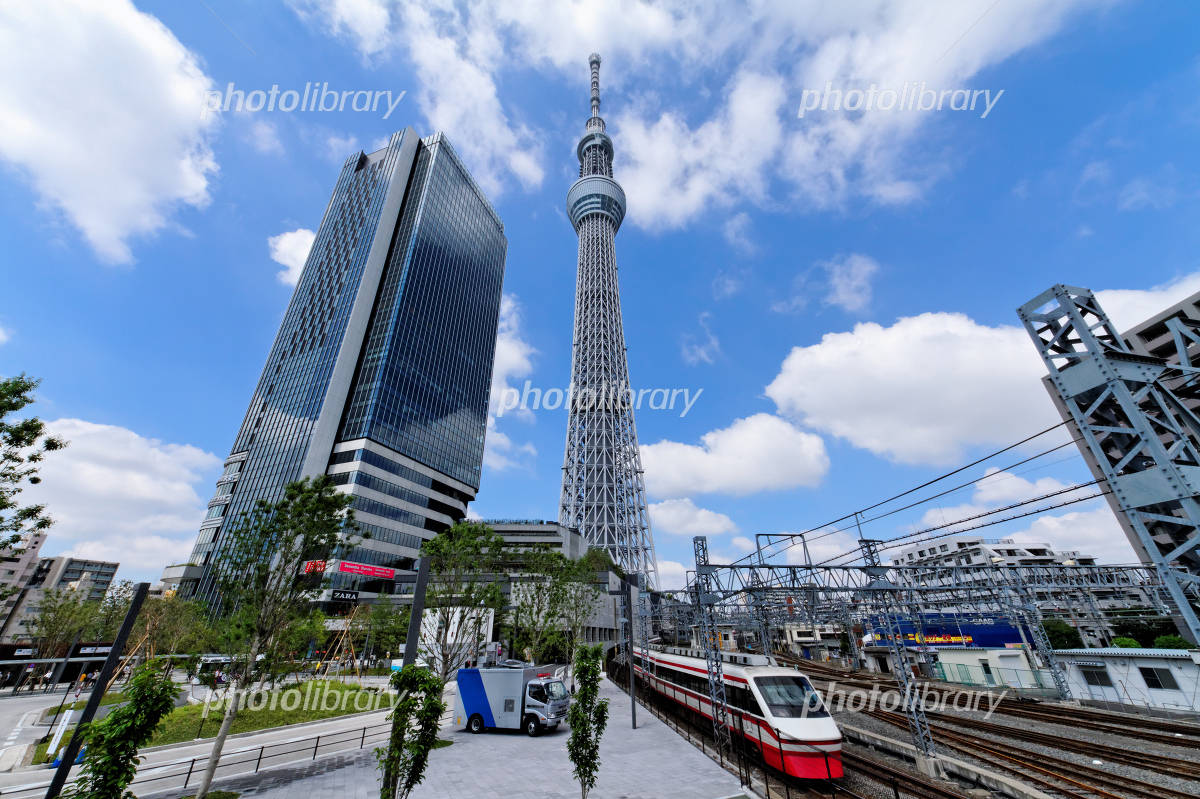 Tokyo Sky Tree and East Tower and limited express train blue sky spreads Photo