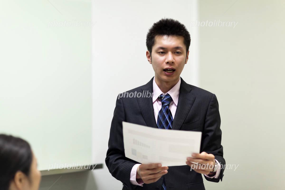 Businessman make a presentation to hand the material Photo