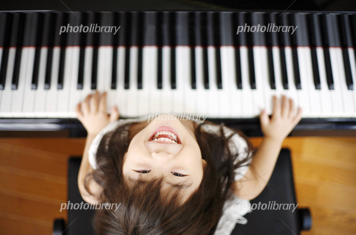 Girl playing the piano Photo