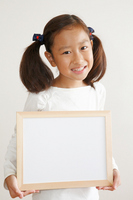 Girl with white board Stock photo [2164980] Girls