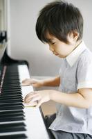 Children playing the piano Stock photo [2167486] Piano