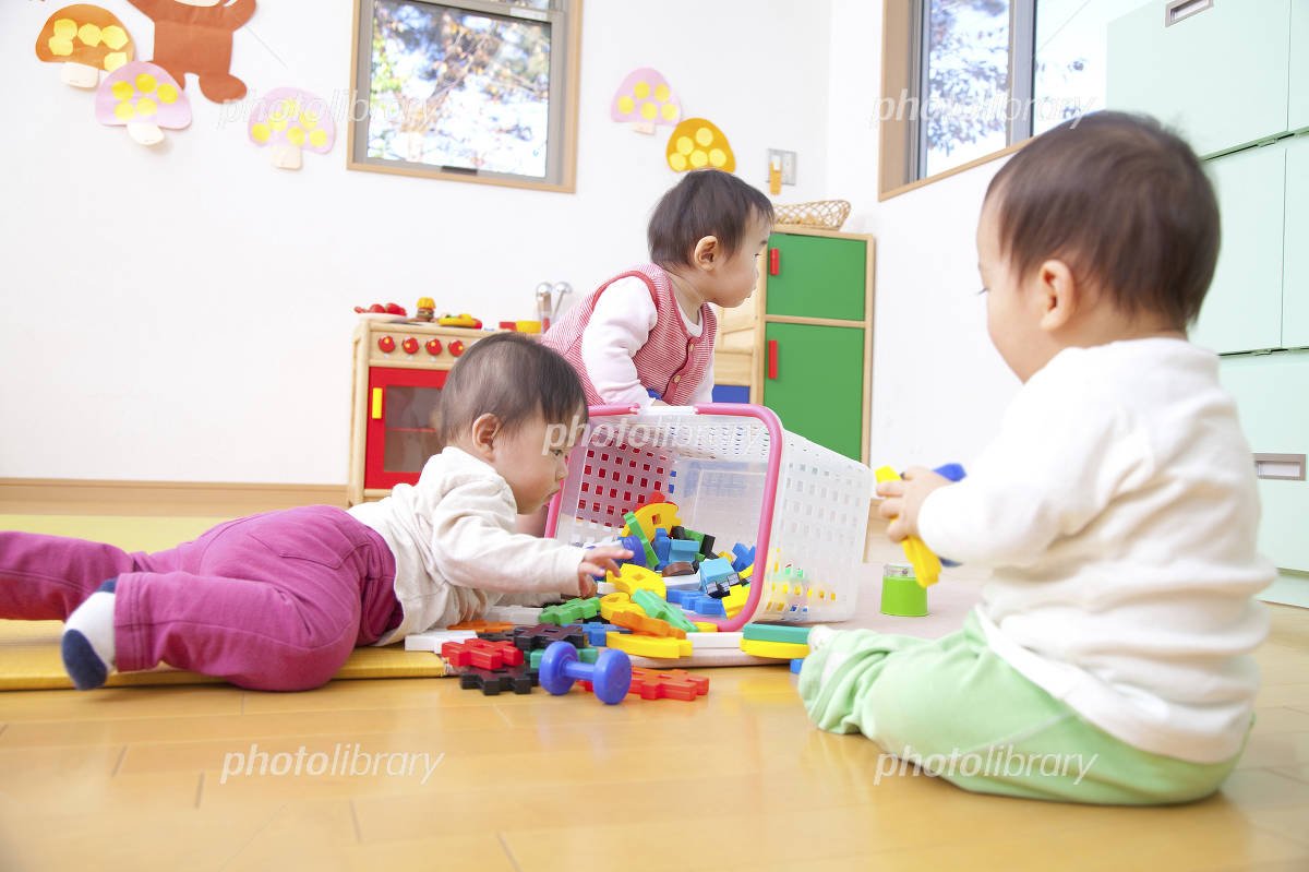 Nursery school children playing with toys Photo