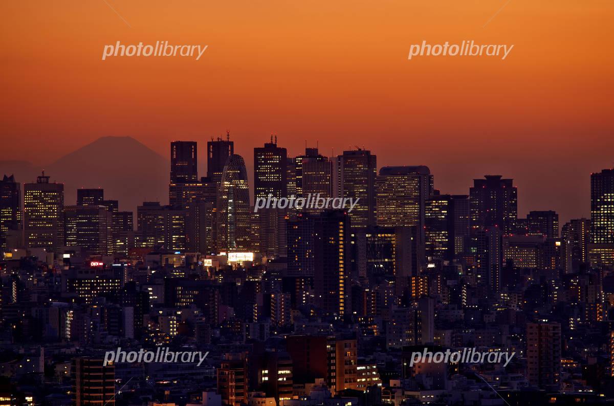 Shinjuku skyscrapers of sunset and Fuji silhouette Photo